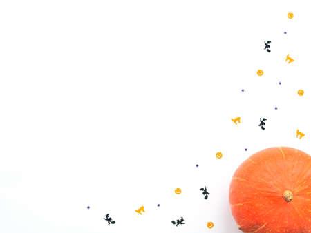 Orange pumpkin and Halloween decorations on white