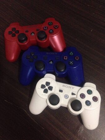 playstation: Three Different Colors of Sony Playstation Joysticks