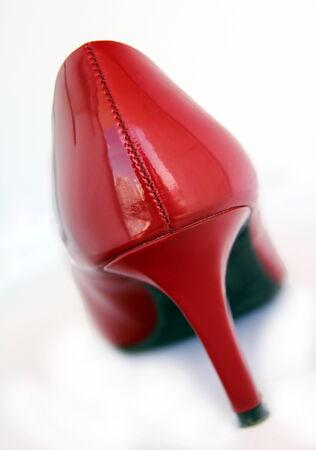 high heeled shoe: A red shiny high heeled shoe