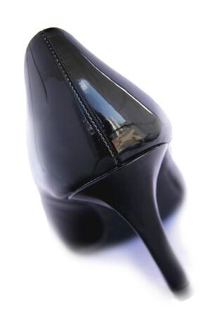 high heeled shoe: A black shiny high heeled shoe