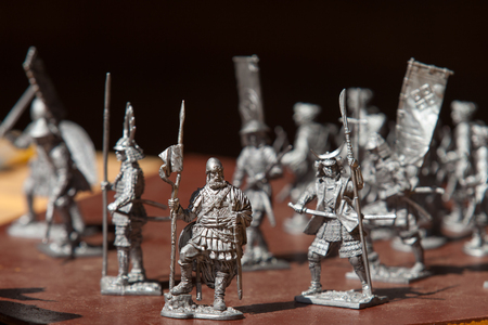reenactment: tin soldiers. a toy soldier made of metal. close up Stock Photo