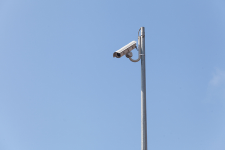 Laterally camera on a post in blue sky