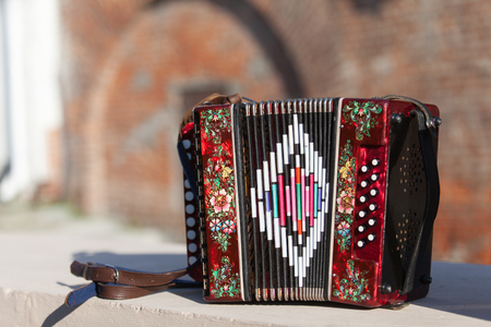 Classic musical instrument an accordion in red color Stockfoto
