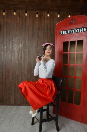 Girl in a red skirt and white blouse, vintage Stock Photo