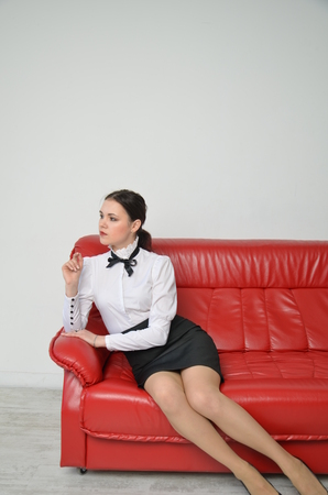 A girl in a strict business suit