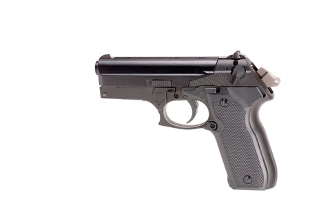 handguns: cocked pistol looking down on white background