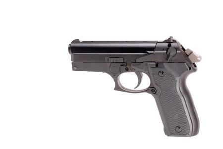 handgun: cocked pistol looking down on white background