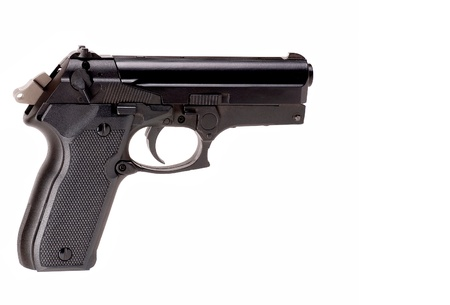 cocked: cocked pistol facing right on white background