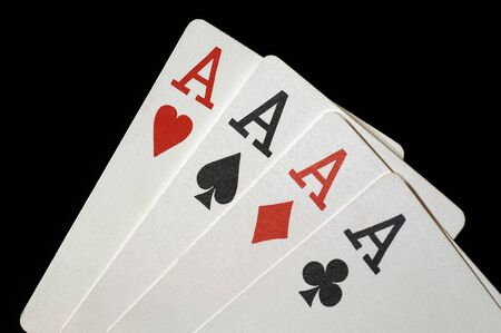 A good hand at Poker on black Four aces
