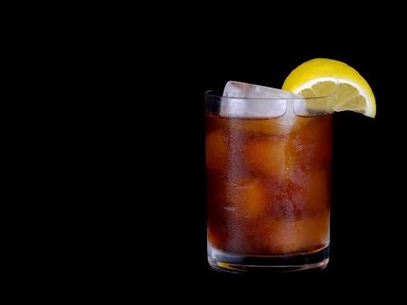 iced tea: Beautiful cold Iced tea with lemon on Black