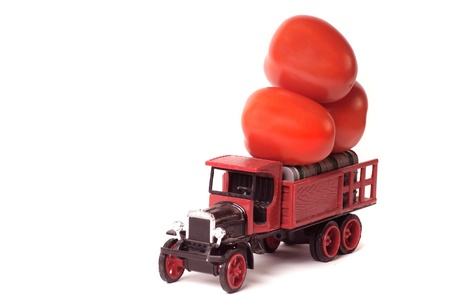 minature: Minature truck with tomatoes  isolated agriculture concept