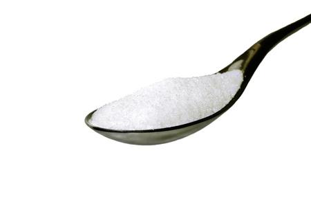 cuiller�e: Gros plan sur une cuiller�e de sucre isol� Banque d'images