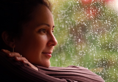ponder: Woman Relaxing During Rain Stock Photo