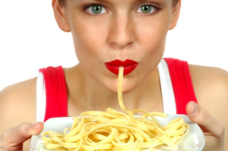 plateful: Woman Eating Pasta Stock Photo