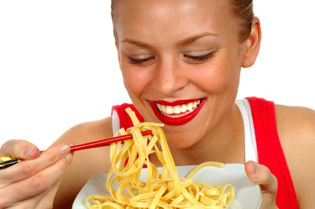 plateful: Woman eating Pasta