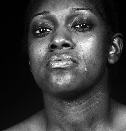 fear: Black Woman Crying  Stock Photo