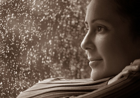 Woman Relaxing During Rain and Thinking about her life Imagens