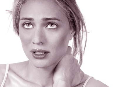 throb: Portrait of young woman with severe neck pain