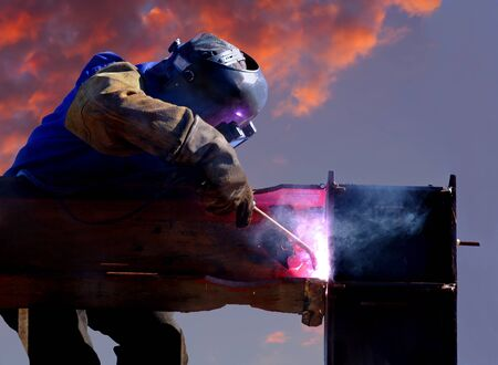 Long Telephoto image of a welder 20 stories above ground