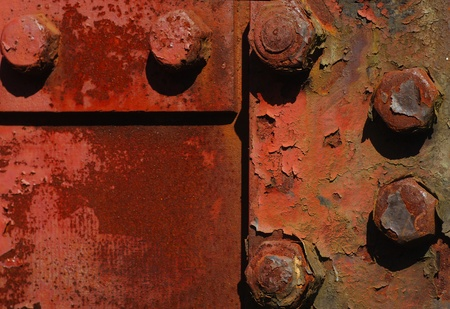 deteriorating: Nice strong Background image of rusted nuts and bolts