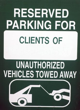 allocated: Image of a green reserved parking for clients only sign Stock Photo