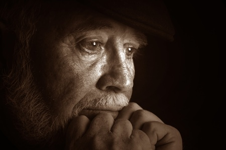 think safety: Dramatic portrait of a elderly man contemplating retirement
