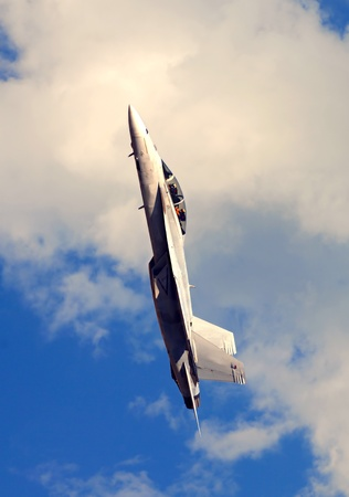 f18: Beautiful Image of F-18 going vertical in blue sky