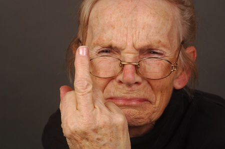 Image of a very Upset,Annoyed Elderly Woman photo