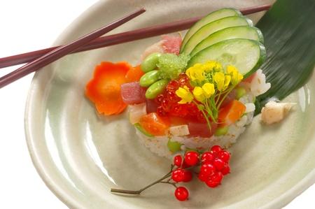 Beautiful Plate of Sashimi on rice with Vegatables photo