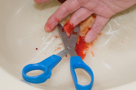 Image of a accident cutting finger with Scissors