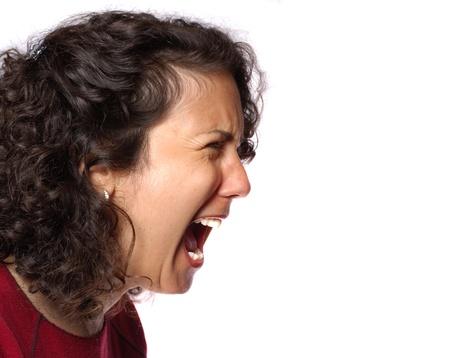 Portrait of a woman yelling her head off 版權商用圖片
