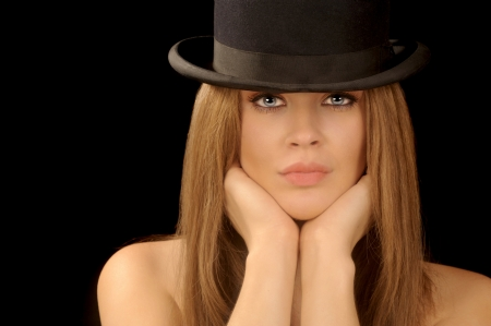 bowler hat: Beautiful image of a woman with vintage bowler hat Stock Photo