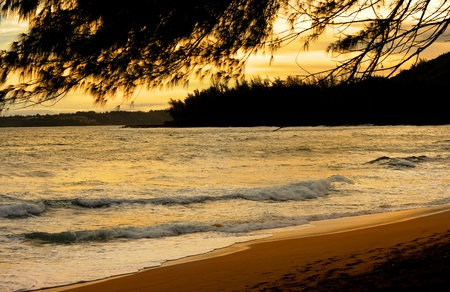 Beautiful Sunrise on a beach In Kauai photo