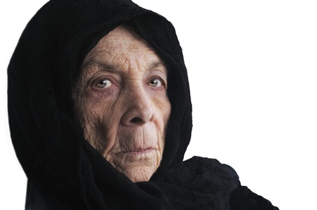 apprehension: Nice isolated portrait of an Elderly lady in Black cape Stock Photo