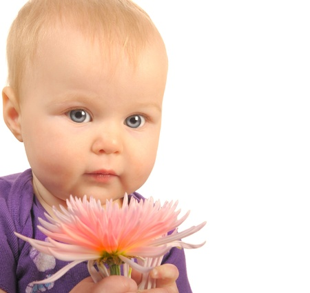 Beautiful Portrait Of a newborn girl Holding a Flower photo