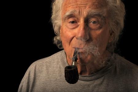 Very Nice Portrait Image of a senior man Smoking a pipe