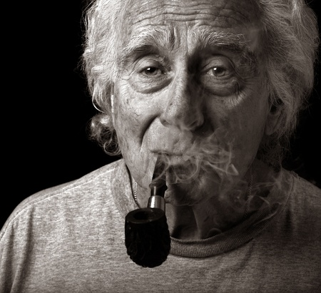 mature smoking: Image of an Elderly Man and His pipe
