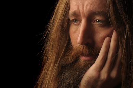 torment: Nice portrait Image of a Long Haired Man On Black