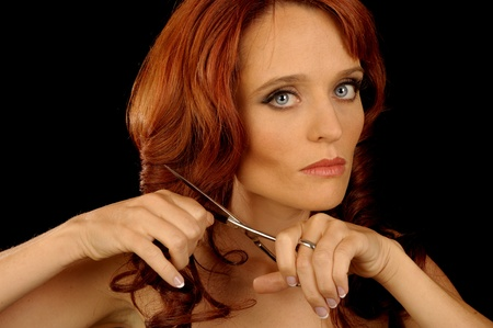 scissors: beautiful Portrait of a Woman Cutting Her Hair Stock Photo
