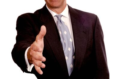 extends: Friendly Business Man extends his hand on white