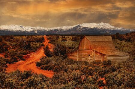 wyoming: Beautiful image of a rural farmhouse with snow on Mountains Stock Photo