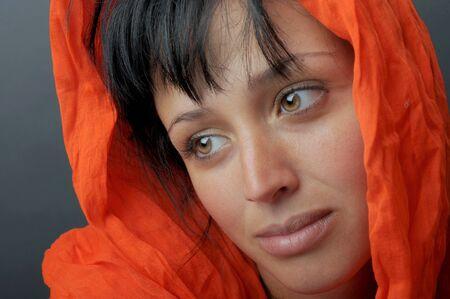 Beautiful Image Of a Latino woman with orange scarf Stock Photo - 10952525