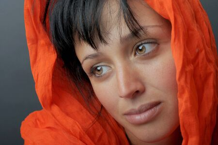 Beautiful Image Of a Latino woman with orange scarf Stock Photo - 10952525