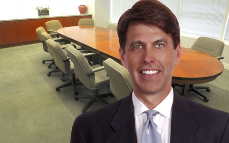 Nice image Of a large boardroom office with businessman