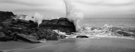 Beautiful image of crashing surf on Coastline , Malibu california photo