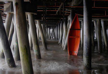 life saving: Beautiful image of a life saving boat under the pier in Santa Monica