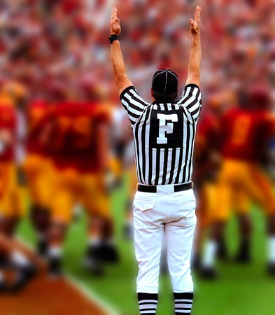 field judge with hands up in american football Stock Photo