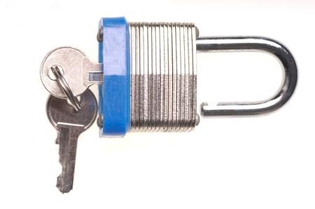 Macro closeup of Unlocked Padlock with keys  isolated photo