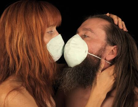 Striking Image of 2 lovers in masks because of fear photo