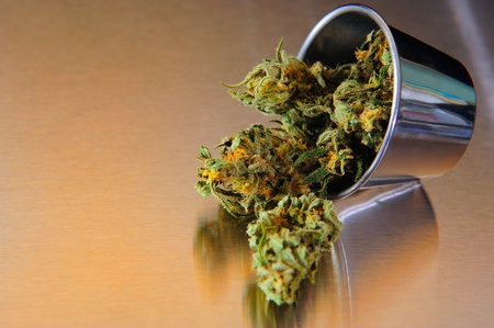 medicinal: Nice Closse up view of marihuana on stainless steel Stock Photo